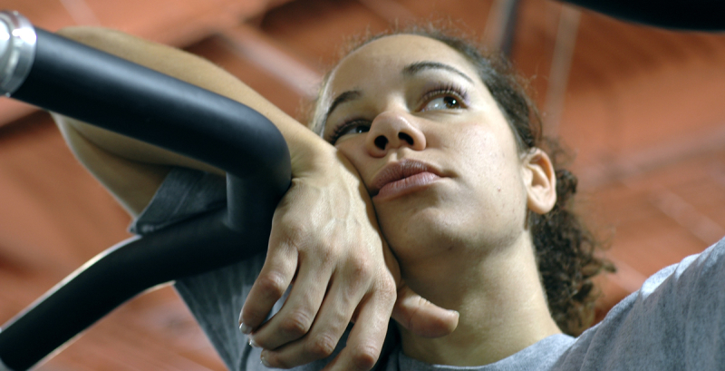 young woman bored at gym